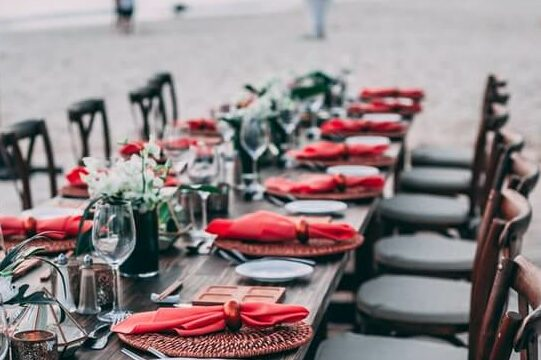 table prepared with plates ready for an event
